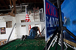 A man prepares the sound system at a campaign stop by Republican presidential hopeful Rick Santorum on Saturday, August 6, 2011 in Roland, IA.