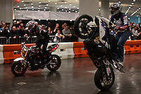 New york, United States. 18th January 2013 -- People attend a show of motorcycles during The International Motorcycle Show in New York. -- BMW, Ducati, Harley-Davidson, Honda, Kawasaki, Suzuki, Star, Triumph, Victory, Yamaha and more have all utilized the International Motorcycle Shows to unveil new motorcycles and concept vehicles to the world. Photo by Eduardo Munoz Alvarez / VIEWpress.