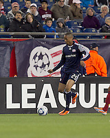 New England Revolution defender Darrius Barnes (25) passes the ball. In a Major League Soccer (MLS) match, Real Salt Lake defeated the New England Revolution, 2-0, at Gillette Stadium on April 9, 2011.