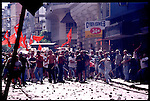 In December 2001 Argentina was caught by street protests when former President Fernando de la Rua froze bank accounts to pay off the country's foreign debt. The continuing protests, street riots, and looting of shops caused De la Rua to resign as well as his successor Interim President Adolfo Rodriguez Saa. To end the country's economic and political turmoil on New Year's Day Argentina's Legislative Assembly decided to appoint Eduardo Duhalde as Argentina's new President until December 2003. Here Communistas throw rocks during a protest that turned into a riot between rival political parties.