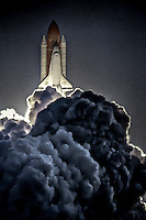Space Shuttle Endeavour rises from a cloud of smoke during blastoff  at Kennedy Space Center, Titusville, FL, to begin the STS 59 mission in April 1994.  (Photo by Brian Cleary/www.bcpix.com)