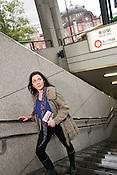 A young Caucasian woman leaving Tokyo subway.