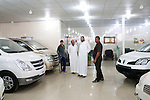 Car salesman Salam Septi, second from right, shows cars to several customers at the Hyundai dealership where he works on Friday, October 22, 2010 in Basrah, Iraq.