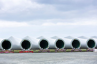 Vanes of Siemens wind turbines to harness renewable wind energy in construction at Esbjerg, South Jutland, Denmark