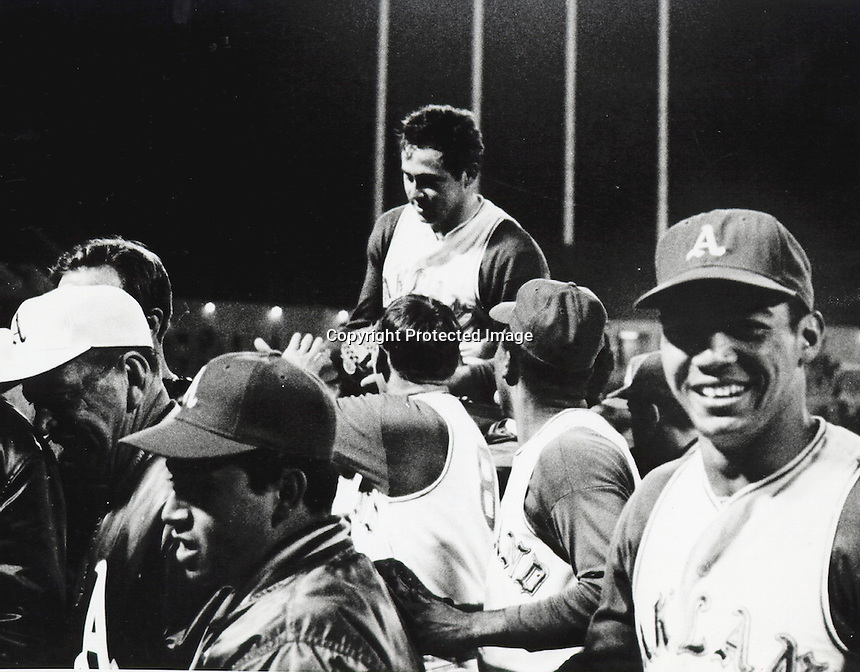 Jim Catfish Hunter is carried off the field by teammates after pitching a perfect game against the Twins. (copyright 1968.Ron Riesterer)