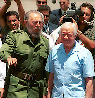 Cuban leader Fidel Castro pictured with the former U.S. President Jimmy Carter at the airport in Havana, Cuba, Friday, May 17, 2002. Carter wrapped up to historic visit Friday after seeking to bring Cuba and the United States closer by challenging both countries to change after than four decades of enmity lives.. Credit: Jorge Rey/MediaPunch