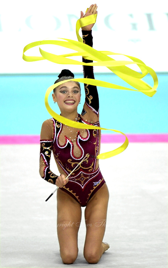 02 OCTOBER 1999 - OSAKA JAPAN:<br /> Alina Kabaeva of Russia performs with ribbon routine on the way to winning All Around gold medal at 1999 World Championships in Osaka.