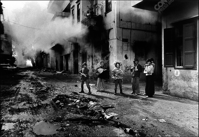Young Christians with the body of a Palestinian girl, Beirut, Lebanon, 1976
