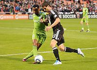 Seattle Sounders defender James Riley (7) defends the play against DC United midfeilder Chris Pontius (13)  DC United defeated The Seattle Sounders 2-1 at  RFK Stadium, Wednesday May 4, 2011.