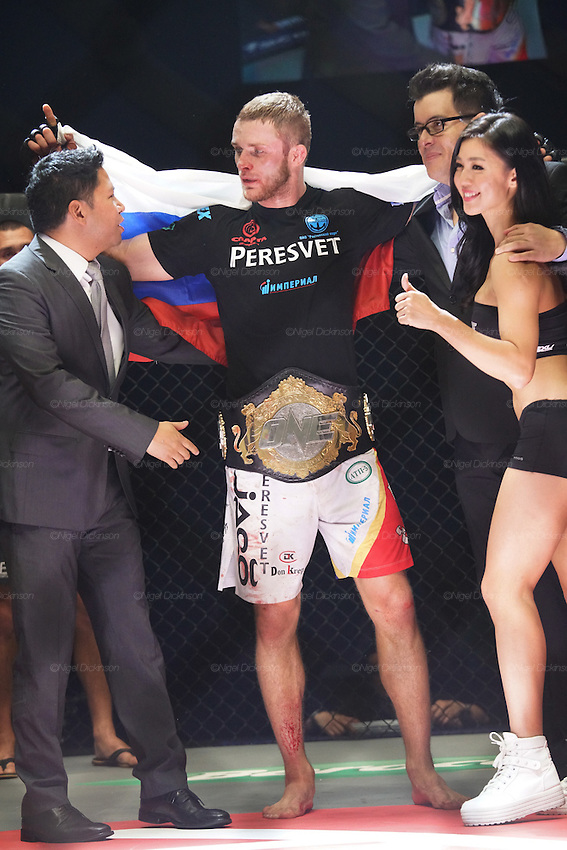 CEO of ONE Victor Cui celebrates with the winner Russian Vitaly Bigdash, Top middleweight champion beats the reigning champion Igor Svirid, One middleweight world champion from Kazakstan<br />