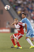 Foxborough, Massachusetts - July 18, 2015: First half action. In a Major League Soccer (MLS) match, the New England Revolution (red) vs New York City FC (blue), 1-0 (halftime), at Gillette Stadium.