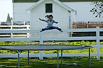 "Jade Woodsmall enjoys the trampoline on the farm near Columbus Junction, Ia., owned by her grandfather, Carl Stogdill.  ""She's lived on the farm since before she was born,"" said grandmother Denise Stogdill.  ""I wish my children would have grown up on a farm.  I think it's good for a child's stability."""