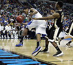 Sophomore guard Darnell Dodson tries to regain possession of the ball in mid air while being guarded by Ishmael Smith during the second half of UK's second round  win, 90-60 over Wake Forest in the NCAA tournament at New Orleans Arena on Saturday, March 20, 2010. Photo by Britney McIntosh | Staff