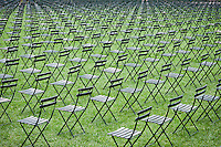 2,753 chairs, all facing the site of the World Trade Center, are set up on the lawn of Bryant Park in midtown in New York on the 10th anniversary of the terrorist attacks, Sunday, September 11, 2011. The chairs represent each of the victims of the Sept. 11 terrorist attack on the World Trade Center and is similar to a memorial erected at the park for the first anniversary. (© Richard B. Levine)
