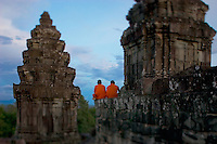 Two Cambodian monks watch the sunset at Angkor Wat, Siem Reap, Cambodia.