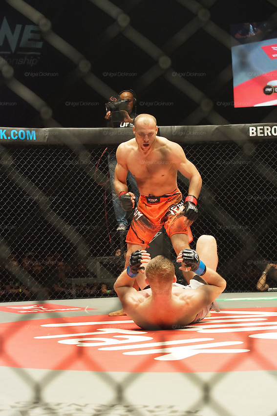 The challenger and eventual winner, (white shorts) Russian Vitaly Bigdash, Top middleweight champion, fights reigning champion Igor Svirid, One middleweight world champion from Kazakstan<br /><br />MMA. Mixed Martial Arts &quot;Tigers of Asia&quot; cage fighting competition. Top professional male and female fighters from across Asia, Russia, Australia, Malaysia, Japan and the Philippines come together to fight. This tournament takes place in front of a ten thousand strong crowd of supporters in Pelaing Stadium. Kuala Lumpur, Malaysia. October 2015