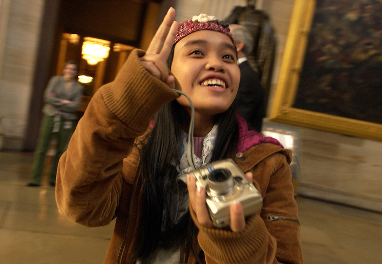 Thuy Anh, a student sponsored by Chief of Staff for Rep. Bart Gordon, D-Tenn., takes in the surroundings of the Rotunda during a Capitol tour.