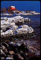 THE MARQUETTE LIGHTHOUSE WITH SNOW FOLLOWING A LAKE EFFECT SNOW STORM ON LAKE SUPERIOR IN MARQUETTE MICHIGAN.