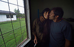 "Zeffie Papamichail and Yasir Nadeem in their room in the Krnjaca Center for Refugees on the outskirts of Belgrade, Serbia. The Greek-Pakistani couple is bound for western Europe, seeking work. ""Not Germany, there are too many people and no jobs,"" said Nadeem. ""We want to go where there is work. I hear England is good,"" said Papamichail."
