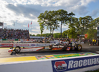 May 30, 2014; Englishtown, NJ, USA; NHRA top fuel driver Clay Millican (near lane) races alongside Bob Vandergriff Jr during qualifying for the Summernationals at Raceway Park. Mandatory Credit: Mark J. Rebilas-