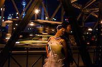 Mickey and Ladia Zhou have their wedding photos made on a bridge with the Pudong skyline in the background.  Mickey's mobile phone is 133 11928710 and his email is mzhou_tenibac@133sh.com