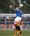 Lee McCulloch sent flying after he wins the ball