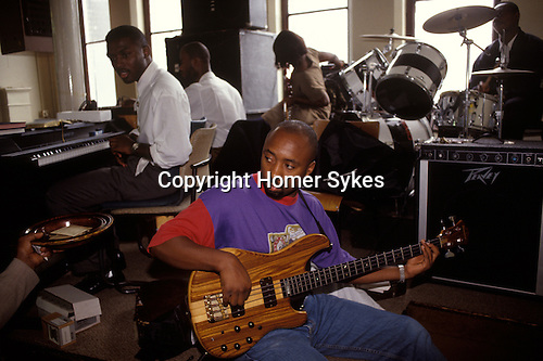 Church of God of Prophecy, north London. The  church band practice before the Sunday service starts. A collection plate goes around.  from A STORM IS PASSING OVER a Look at Black Churches in Britain. Published by Thames and Hudson isbn 0 500 27826 1
