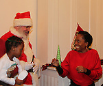 Actress and singer Rhonda Ross (Another World) happy to see Santa Claus - Hearts of Gold links to a better life celebrates Christmas with a party #2 for mothers and their children on December 17, 2016 in New York City, New York with arts and crafts, a great turkey dinner with all the goodies and then the children met Santa Claus and had a photo with him as he gave them gifts. (Photo by Sue Coflin/Max Photos)
