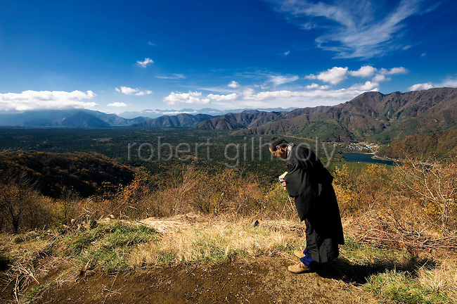 A priest of the Jodo Shinshu sect of Buddhism, offers prayer for those who committed suicide in Aokigahara Jukai, better known as the Mt. Fuji suicide forest, in Yamanashi Prefecture, west of Tokyo, Japan on 04 Nov. 2009. .