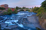 Washington, Spokane, Riverfront Park. The historic Flour Mill building  and rapids on the Spokane River above the falls.