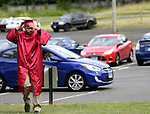 Wolcott, CT- 13 June 2016-061316CM06-  Wolcott High School graduate Nate Fillipone gets ready before the start of commencement exercises on Monday.    Christopher Massa Republican-American