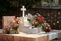 Graves decorated with flowers in the town cemetery, El Quelite near  Mazatlan, Sinaloa, Mexico