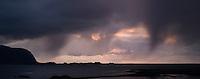 Autumn storm sweep over Eggum as seen from Sandøya,  Lofoten islands, Norway