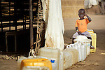 A displaced boy sits waiting his chance to fill water containers in Agok, a town in the contested Abyei region where tens of thousands of people fled in 2011 after an attack by soldiers and militias from the northern Republic of Sudan on most parts of Abyei, which sits on the contested border between Sudan and South Sudan..