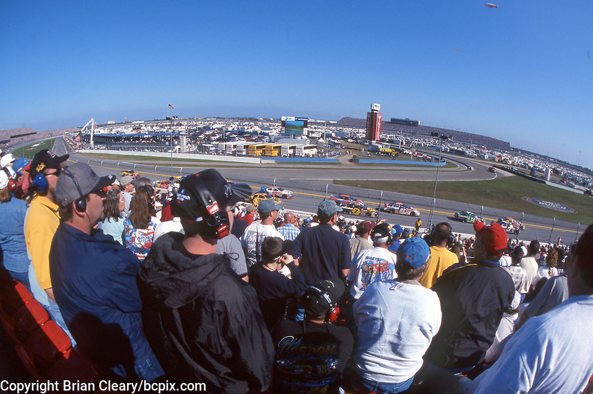 Fand watch the action from the grandstand during the Daytona 500, Daytona International Speedway, Daytona Beach, FL, February 18, 2001.  (Photo by Brian Cleary/www.bcpix.com)