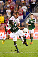 Teemu Tainio (6) of the New York Red Bulls collides with Diego Chara (21) of the Portland Timbers. The New York Red Bulls  defeated the Portland Timbers 3-2 during a Major League Soccer (MLS) match at Red Bull Arena in Harrison, NJ, on August 19, 2012.