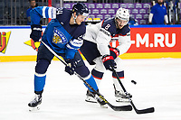 American Jacob Trouba (R) steals the puck from Finland's Jani Lajunen during the Ice Hockey World Championship quarter-final match between the US and Final in the Lanxess Arena in Cologne, Germany, 18 May 2017. Photo: Marius Becker/dpa /MediaPunch ***FOR USA ONLY***