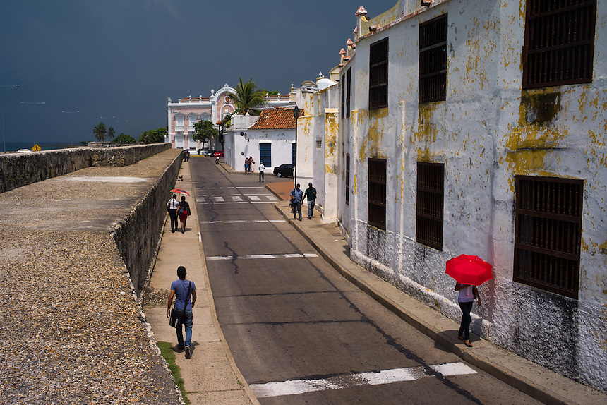A red umbrella along the fortified wall of Cartagena, Colombia.