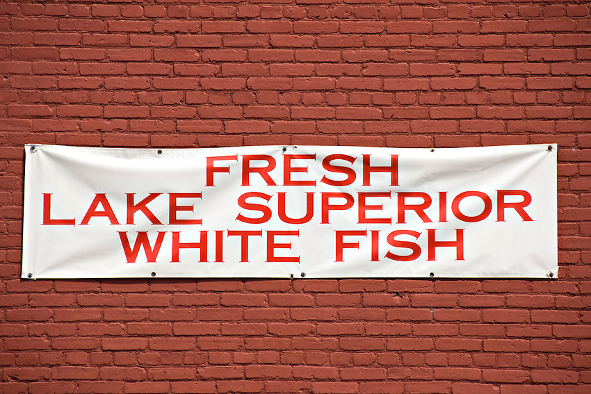 A sign for Fresh Whitefish at The Vierling Restaurant and Marquette Harbor Brewery in downtown Marquette Michigan.