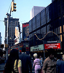 The film French connection II at a cinema, and the famous Winston smoking hoarding, Times square, New York, 1975.