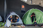 A family from Afghanistan has lunch inside their tent at a makeshift camp in the Budapest Keleti railway station. The family wants to settle in Sweden.<br /> <br /> Hundreds of refugees from mostly Syria and Afghanistan gather at the Budapest Keleti railway station waiting for trains to leave for destinations such as Austria, Germany and Sweden, in Budapest, Hungary, on Tuesday, Sept. 8, 2015. Hungary's Prime Minister Viktor Orban created an anti-refugee campaign to generate hate against those fleeing war in their home countries. The country is currently 50% xenophobic and the government has become increasingly authoritarian.