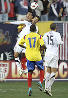 Benny Feilhaber #22 of the USA MNT goes up for a header with John Javier Restrepo #21 of Colombia during an international friendly match at PPL Park, on October 12 2010 in Chester, PA. The game ended in a 0-0 tie.