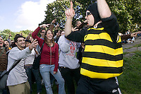 "16 October 2005 - New York City, NY - People following Chris Qula (bee costume) gesture as instructed by the file playing on their handheld digital music players in Central Park, New York City, USA, 16 October 2005, during a so-called ""MP3 Experiment"" organized by Improv Everywhere, a group of young artists which seek to organize bizarre, anonymous happenings and pranks."