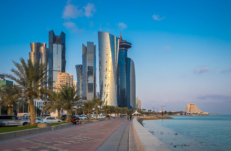 DOHA, QATAR - CIRCA DECEMBER 2013: Famous Corniche and skyline in Doha at sunset.