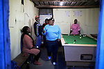 CAPE TOWN, SOUTH AFRICA - OCTOBER 19: Phato Mkhosana dances to hiphop music while her lesbian friends play pool in a gay only bar on October 19, 2011 in Khayelitsha outside Cape Town, South Africa. Cape Town is a city known for tolerating gays and lesbians except in the townships where they get harassed and often attacked. Some women have been raped in so called corrective rape, where men rapes them to make them women again. They can't show their love freely on the streets in the townships so they usually have to meet in houses and this bar.  (Photo by Per-Anders Pettersson)