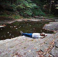 Man by river in Ithaca