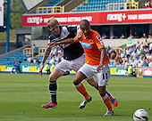 Elliot Grandin, Blackpool FC carefully holds off Andy Keogh, Millwall FC as the ball heads safely out of play - Millwall vs Blackpool - NPower Championship Football at the New Den, London - 18/08/12 - MANDATORY CREDIT: Ray Lawrence/TGSPHOTO - Self billing applies where appropriate - 0845 094 6026 - contact@tgsphoto.co.uk - NO UNPAID USE.