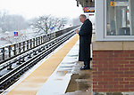 March 8, 2013 - Merrick, New York, U.S. -   Though the Long Island Railroad schedule remains good despite slushy snowfall Friday afternoon on South Shore of Long Island, the cold wet winds reach even the passengers waiting under the protective overhang of the elevated Merrick Train Station.