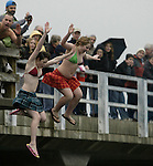 A couple of girls leap off the bridge while participating in the 23rd annual Olalla polar bear jump into the Burley lagoon in Olallar, Washington on January 1, 2007. Jim Bryant Photo. ©2010. ALL RIGHTS RESERVED.