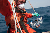Jakob Namminga of Greenpeace does a test of water and seaweed radiation contamination sampling equipment, on an inflatable from the Greenpeace ship Rainbow Warrior, as it sails to Fukushima in Japan, on Tuesday 26th April 2011.